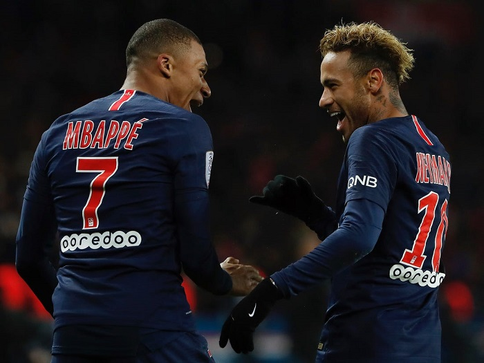 Paris Saint-Germain forward Neymar with team-mate Kylian Mbappe