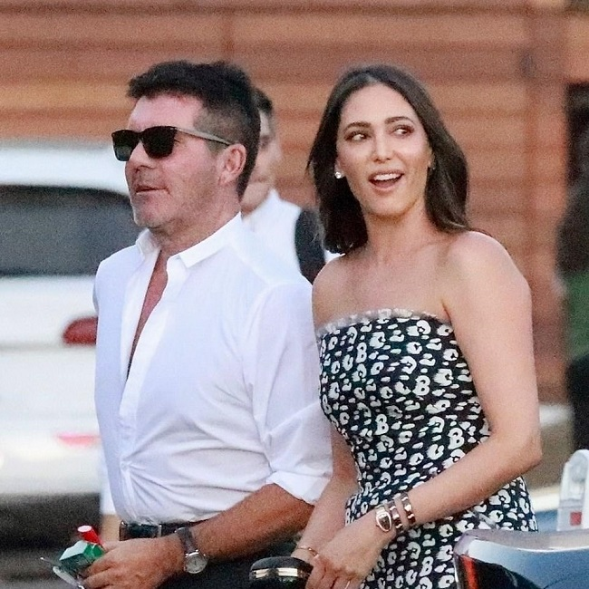 Simon Cowell with loved one